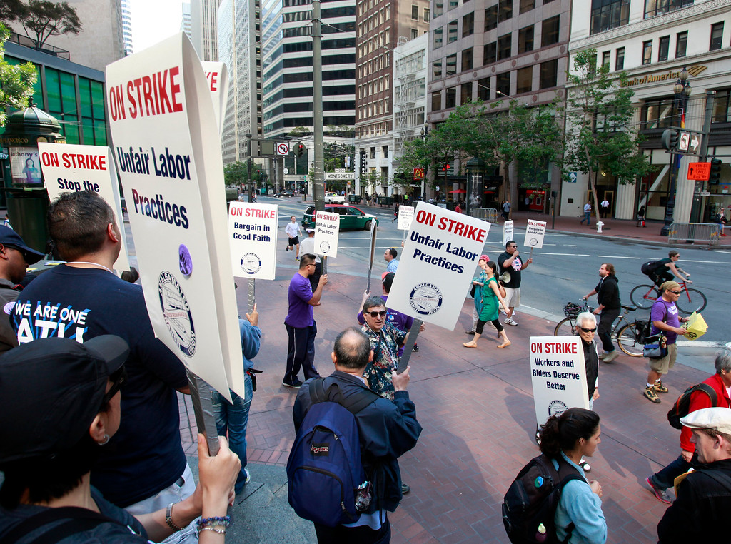 . BART employees picket at Market and Montgomery Streets above a downtown San Francisco BART station Monday morning, July 1, 2013, the first day of the BART strike. (Karl Mondon/Bay Area News Group)