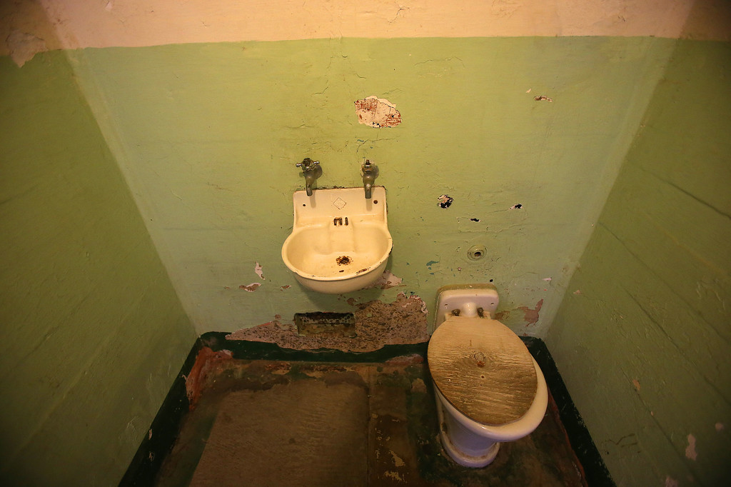 . A sink and toilet are photographed in a prison cell on Alcatraz Island on Monday, March 18, 2013 in San Francisco, Calif. The federal prison on the island closed 50 years ago and is now a tourist destination.  (Aric Crabb/Staff)