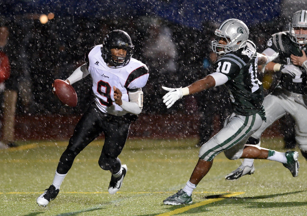 . <p>11. VICTOR EGU � LINEBACKER � DE LA SALLE</p> James Logan High\'s quarterback Jeffrey Prothro (9) left, looks for an open receiver while trying to outrun Egu (10) in the second quarter of their North Coast Section Division I championship football game in Dublin, Calif., on Saturday, December 1, 2012. (Doug Duran/Staff)