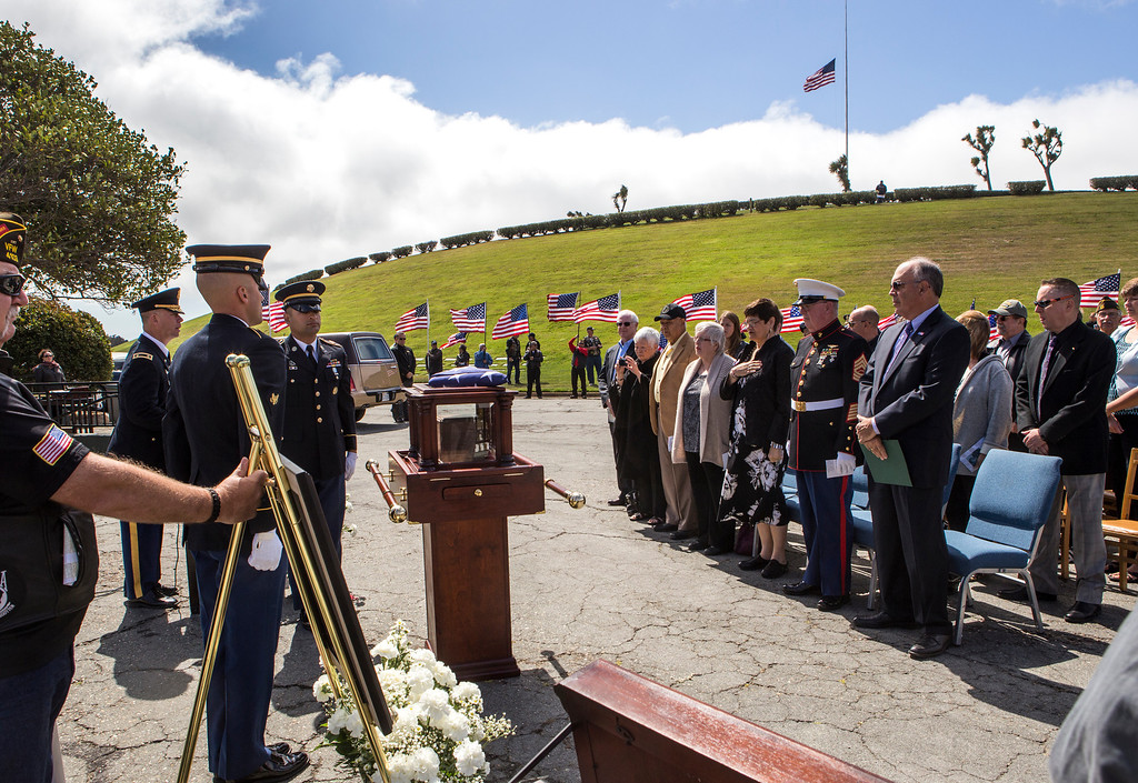 . Marlene Baisa, middle, the niece of Sgt. 1st Class Joseph Steinberg and other family members attend the interment of Steinberg at Golden Gate National Cemetery in San Bruno, Calif., on Aug. 1, 2013. Steinberg who disappeared as a POW during the Korean War, died on April 30, 1951. His remains were recently identified with the use of DNA and returned 62 years after he went missing. Steinberg was interred at Golden Gate National Cemetery alongside his three brothers, all of whom were WWII veterans. (John Green/Bay Area News Group)