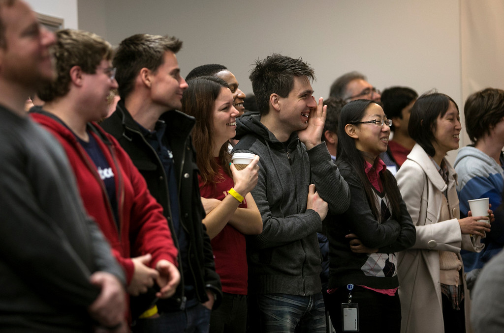 . Facebook employees watch as Mark Zuckerberg announce Graph Search during a press conference at Facebook in Menlo Park, Calif., on Tuesday, Jan. 15, 2013. (John Green/Staff)
