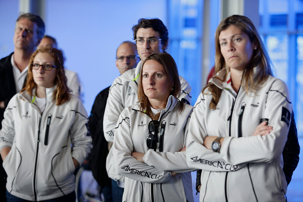 ". America\'s Cup staff members, left to right, Briana Billingham, Melanie Roberts and Sarah Hawkins listen in on a press conference on yesterday\'s training tragedy in San Francisco, Calif. on Friday, May 10, 2013. Two-time Olympic medalist, Andrew ""Bart\"" Simpson was killed yesterday afternoon when the Artemis Racing team\'s 72-foot catamaran capsized during a practice run for America\'s Cup in the San Francisco Bay. Simpson was trapped beneath the boat and died after efforts to revive him failed.  (Gary Reyes/ Bay Area News Group)"