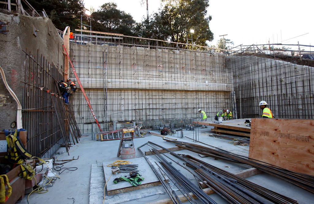 . Ironworkers attach rebar to the East Portal of the Caldecott Tunnel fourth bore project Friday afternoon Jan. 18, 2013 near Orinda, Calif. The long-awaited project expects to open sometime in the latter part of 2013. (Karl Mondon/Staff)