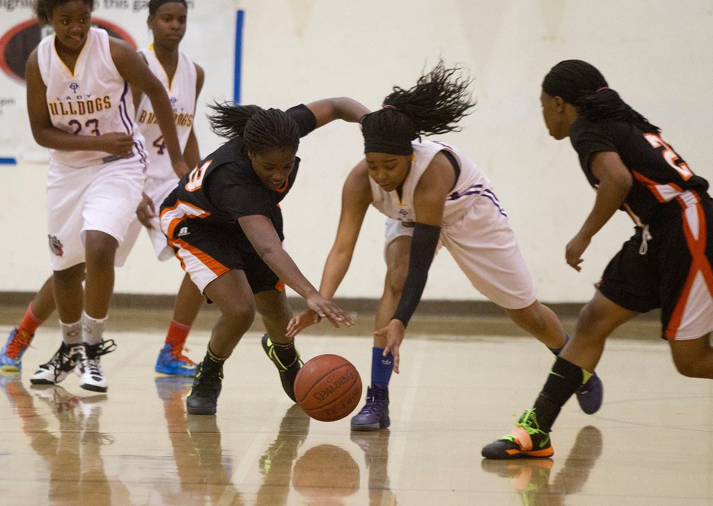 . McClymonds High School\'s Breannie Robinson, third from left, and Oakland Technical High School\'s London Robinson vie for a loose ball during the first quarter of their Oakland Athletic League girls\' basketball game, Wednesday, Feb. 20, 2013 in Oakland, Calif. McClymonds won, 62-50. (D. Ross Cameron/Staff)