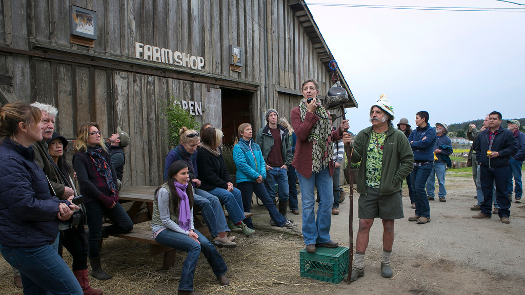 . Farmer Dee Harley, left, and tour leader Amigo Bob Cantisano, right, talk with participants of the EcoFarm Conference at Harley Farms in Pescadero, Calif., on Wednesday, Jan. 23, 2013. Harley, 46, shared what she\'s learned with three busloads of farmers, students, activist and other participants of the 33rd annual EcoFarm Conference in Pacific Grove, devoted to sustainable agriculture. (John Green/Staff)