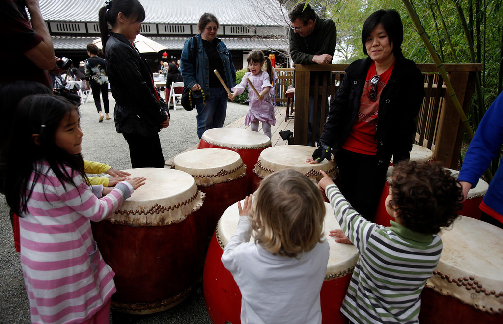 ". Prospective future percussionists check out he Ladies Drumming Group before it takes center stage at Hakone Estate and Gardens during a Lunar New Year of the Snake festival with a ""Chinese Village Fair\"" on Sunday afternoon, March 3, 2013 in Saratoga, Calif. (Karl Mondon/Staff)"