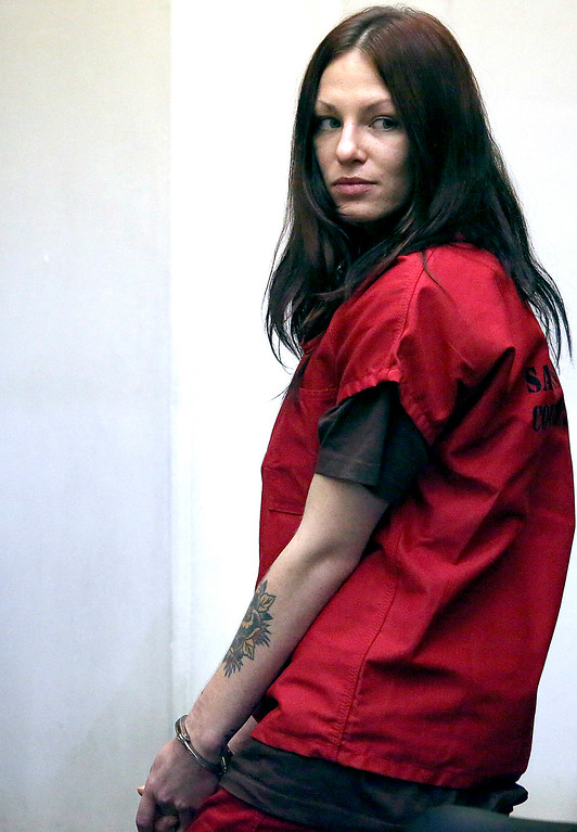 . Alix Tichelman looks back toward her family in Department 3 of Santa Cruz County Superior Court as she leaves her arraignment on Wednesday. (Shmuel Thaler/Santa Cruz Sentinel)