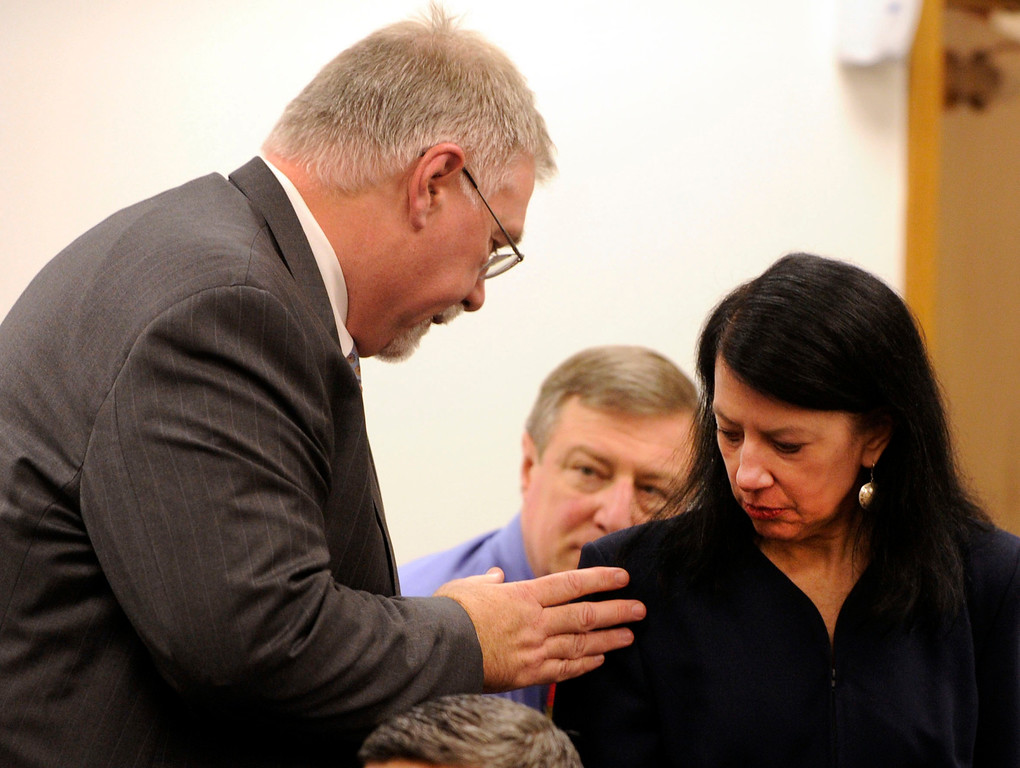 . Dr. David Durand, chief of pediatrics for Children\'s Hospital Oakland put his hand on the shoulder of Dr. Robin Shanahan, a pediatric neurologist at the hospital, during a hearing to determine the fate of 13-year-old Jahi McMath, in Department 31 of  Alameda County Superior Court in Oakland, Calif., on Tuesday, Dec. 24, 2013. Judge Evelio Grillo on Tuesday denied a petition by the family of Jahi McMath to have Children\'s Hospital Oakland keep the brain-dead girl on a ventilator past Dec. 30. Shanahan testified during the proceedings. (Susan Tripp Pollard/Bay Area News Group)