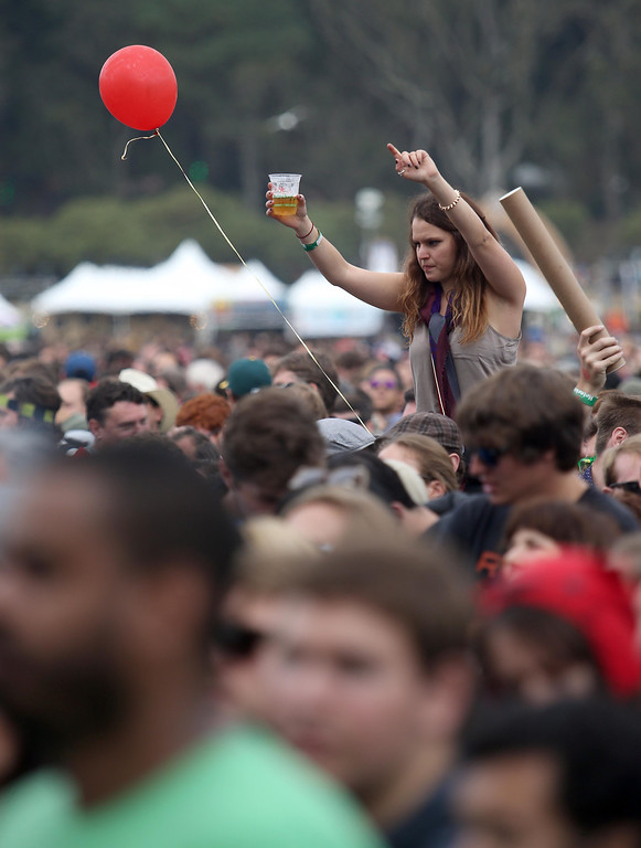 . A festivalgoer dances on a friend\'s shoulders at the Twin Peaks stage during the 6th annual Outside Lands Music and Arts Festival in Golden Gate Park in San Francisco, Calif., on Friday, Aug. 9, 2013. (Jane Tyska/Bay Area News Group)