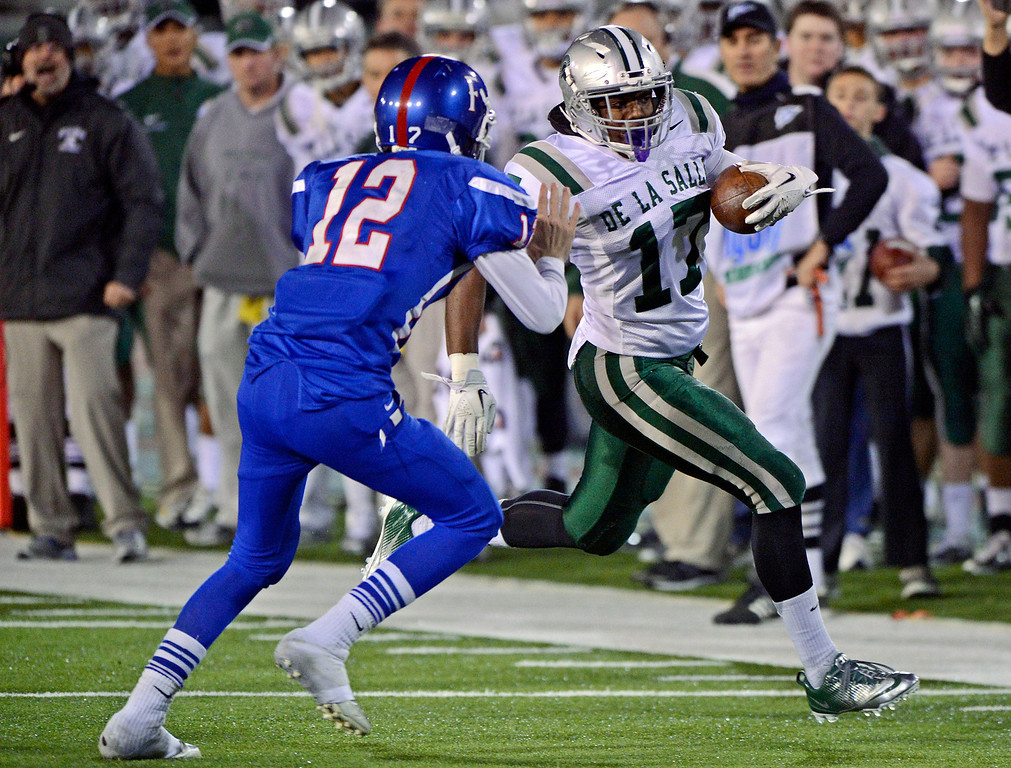 . <p>1. MICHAEL HUTCHINGS � LINEBACKER � DE LA SALLE </p> Hutchings (17) runs back an interception and is tackled by Folsom quarterback Jake Browning (12) in the second quarter of their Northern California Open Division regional game at Hornet Stadium at California State University in Sacramento, Calif. on Saturday, December 8, 2012. (Jose Carlos Fajardo/Staff)