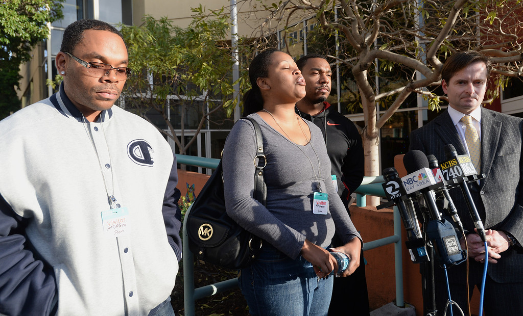 . Nailah Winkfield, second from left, asks for prayers for her and Milton Winkfield\'s, far left, daughter in front of Oakland\'s Children\'s Hospital in Oakland, Calif., on Tuesday, Dec. 17, 2013. Winkfield and McMath\'s daughter Jahi McMath, 13, was declared brain dead following complications from a three-part surgery to remove her tonsils and clear tissue from her nose and throat to treat her sleep apnea and other health issues. Also in the photo are Jahi\'s uncle Omari Sealey and attorney Chris Dolan, far right. (Dan Honda/Bay Area News Group)
