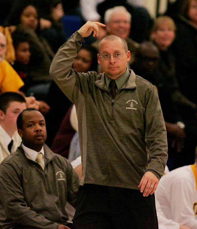 . St. Francis coach Mike Motil signals to his players in the fourth quarter during the CCS Division II boys basketball finals at Santa Clara High School in Santa Clara, Calif. on Friday, March 1, 2013. The Saint Francis Lancers beat the Willow Glen Rams, 56-46. (Jim Gensheimer/Staff)