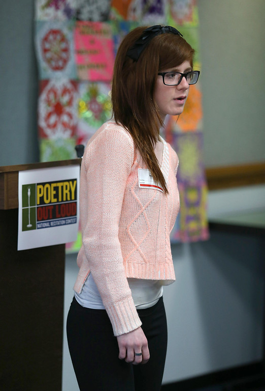 """. Maawa Alhafid, of Foothill High School in Pleasanton, reads \""""Alone\"""" by Edgar Allen Poe during the Poetry Out Loud competition at the Alameda County Lakeside Plaza Building in Oakland, Calif., on Wednesday, Feb. 13, 2013.   (Jane Tyska/Staff)"""