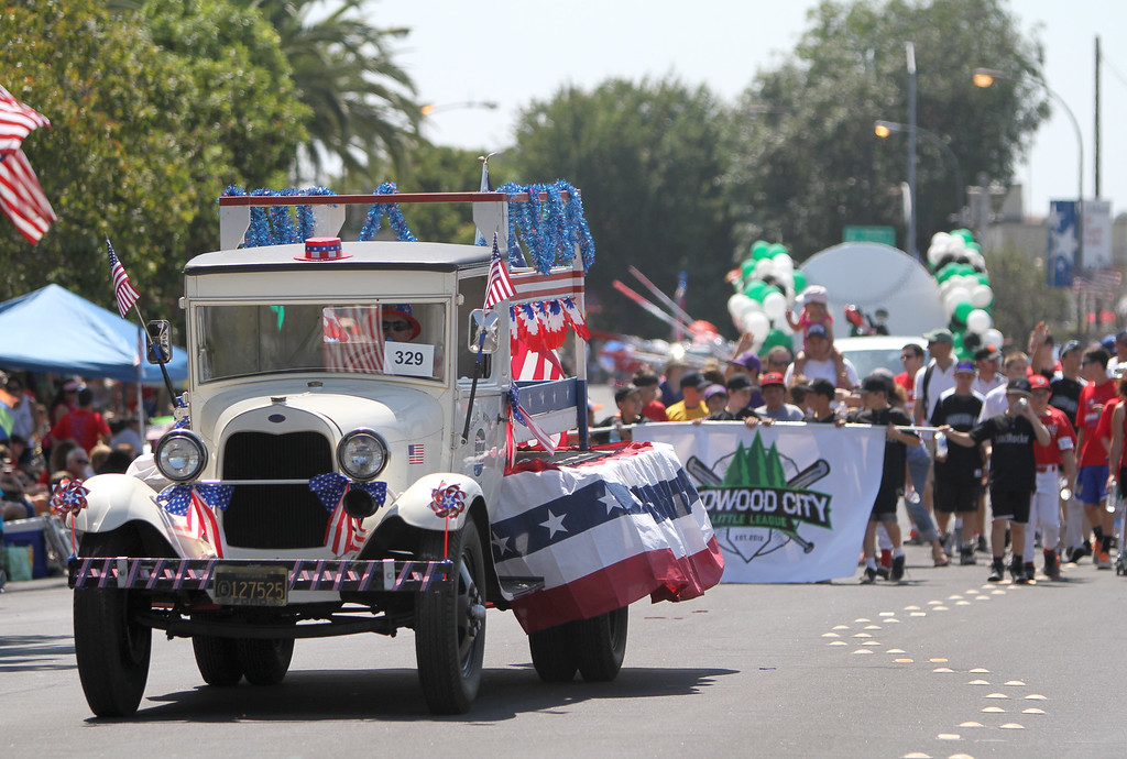 . A decorated Redwood City Public Works car goes down Arguello Street in Redwood City\'s 75th annual Fourth of July Parade on Thursday, July 4, 2013. (Kirstina Sangsahachart/ Daily News)