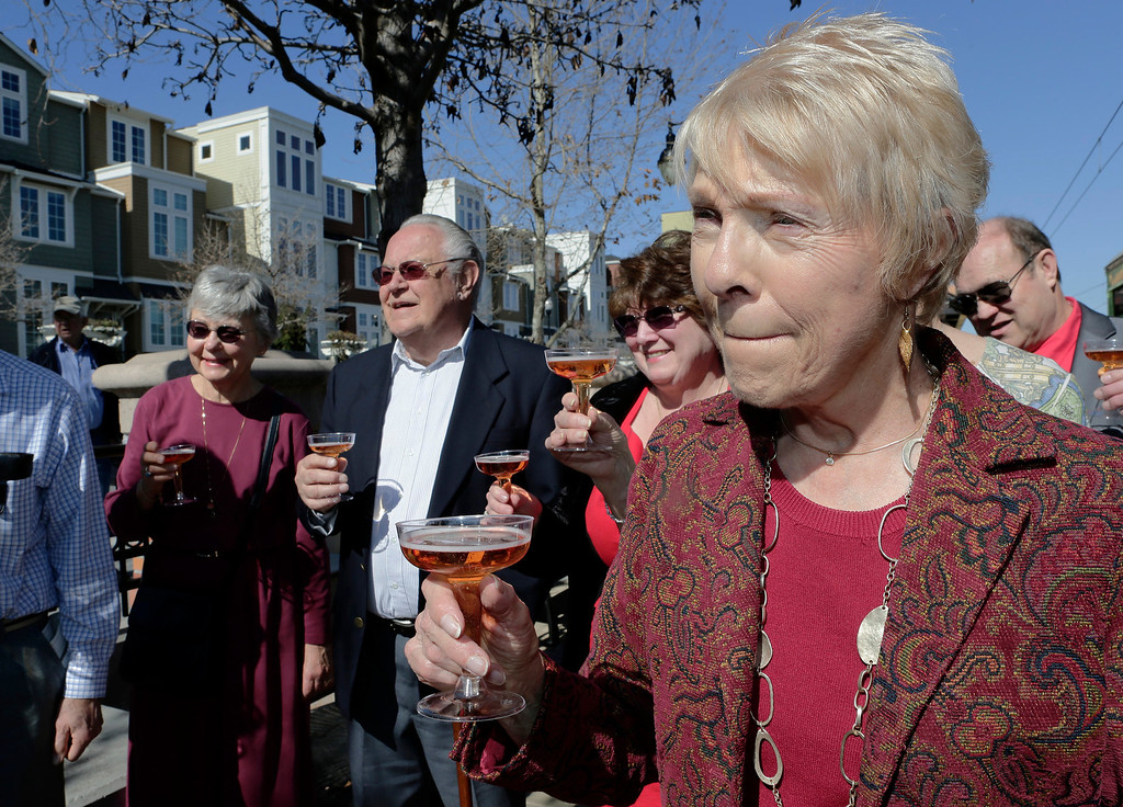 . From left: Jesslyn Holombo, Ron Manzi, Eleanor Foy and Vi Schick join Ralph and Mary Lou Watkins in a toast to celebrate the Watkins\'  60th wedding anniversary on Valentine\'s Day at the Santa Clara Valley Transportation Authority\'s  Diridon Station in San Jose, Calif. on Thursday, Feb. 14, 2013. Ralph, 82, and Mary Lou, 79, won an essay contest sponsored by the VTA to have the opportunity to renew their vows on historic trolley, Car 2001. The couple held a private ceremony aboard the trolley and held a brief reception on the VTA Light Rail platform.  (Gary Reyes/ Staff)
