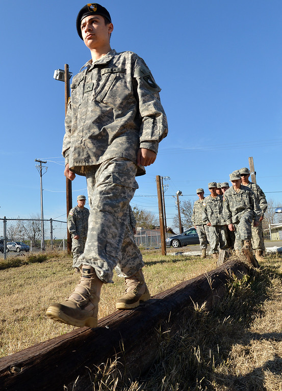 . Boy Scout Arlen Salguero of Oakley walks across a plank during an exercise at his battalion headquarters in Bethel Island, Calif., on Saturday Jan. 19, 2013. A group of eighteen boys are in a branch of the Boy Scouts know as Venturing. The East County club, the only Army-oriented one in northern California , not only gives kids a taste of military life but teaches them respect for authority, courtesy and self-confidence. (Dan Rosenstrauch/Staff)