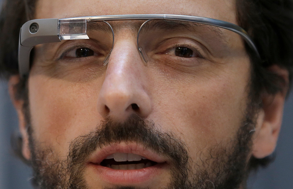 . Google co-founder Sergey Brin wears Google Glass glasses at an announcement for the Breakthrough Prize in Life Sciences at Genentech Hall on UCSF�s Mission Bay campus in San Francisco, Wednesday, Feb. 20, 2013. (AP Photo/Jeff Chiu)