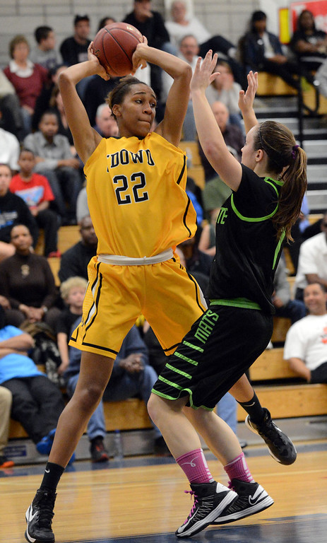 . Bishop O\'Dowd High\'s Oderah Chidom (22) left, looks for an open teammate to pass the ball to as Miramonte High\'s Megan Reid (1) tries to block in the forth period of their Division III North Coast Section basketball game in Dublin, Calif., on Saturday, March 2, 2013. Bishop O\'Dowd High went on to win the game 77-48. (Doug Duran/Staff)