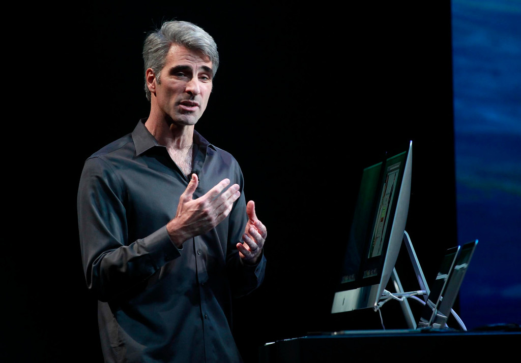 . Apple software executive Craig Federighi talks about the company\'s new PC operating system, Mavericks, named in honor of the Bay Area surfing spot. Federighi spoke Tuesday morning, Oct. 22, 2013 in San Francisco, Calif., at a company release event for their new iPad Air. (Karl Mondon/Bay Area News Group)