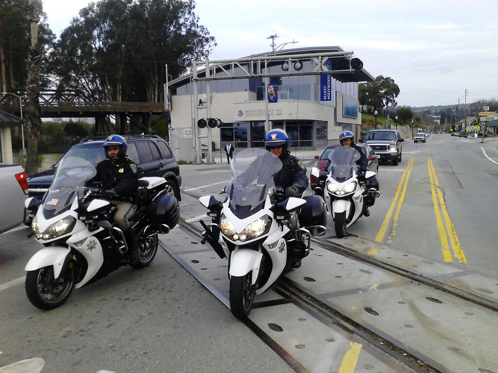". Law enforcement on motorcycles prepare to join the upcoming memorial motorcade to San Jose for the funeral of Santa Cruz police officers Sgt. Loran ""Butch\"" Baker and Detective Elizabeth Butler on Thursday, March 7, 2013, in Santa Cruz, Calif. (Cathy Kelly/Santa Cruz Sentinel)"