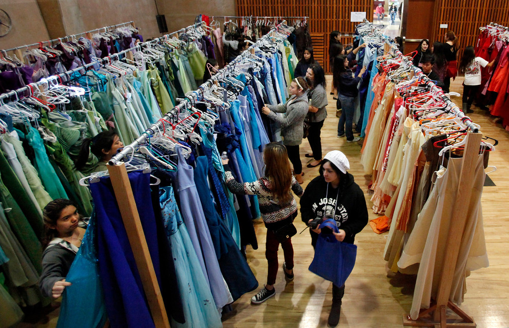 . Operation Prom Dress held its fifth annual event Sunday, March 10, 2013 at Seven Trees Community Center in San Jose, Calif. , letting 800 girls pick a prom dress without any worry about the expense.  Since 2009, the office of Vice Mayor Madison Nguyen has given out more than 3000 dresses. (Karl Mondon/Staff)
