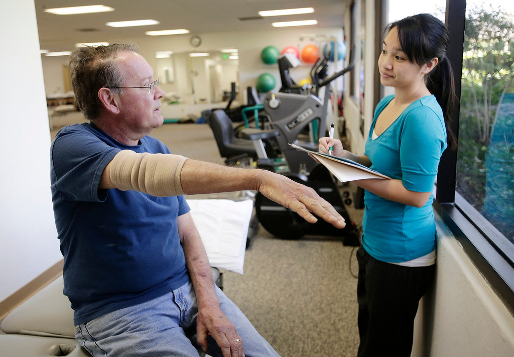 . Gary Richards, Mercury News Roadshow columnist, goes over exercises with his therapist, Lisa Yee, during physical therapy session for a heel problem in Cupertino, Calif. on Thursday, Feb. 28, 2013.  Richards is the Mercury News Roadshow columnist who is calling attention to aging motorists and the issues they face. (Gary Reyes/ Staff)