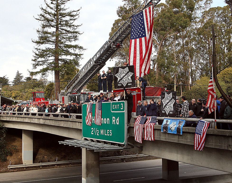 ". Santa Cruz residents join firefighters on the Pasatiempo Highway 17 overpass in Santa Cruz, Calif., on Thursday, March 7, 2013, to pay their respects to the passing funeral procession for slain Santa Cruz Police detectives Sgt. Loran ""Butch\"" Baker and Elizabeth Butler.  (Dan Coyro/Santa Cruz Sentinel)"