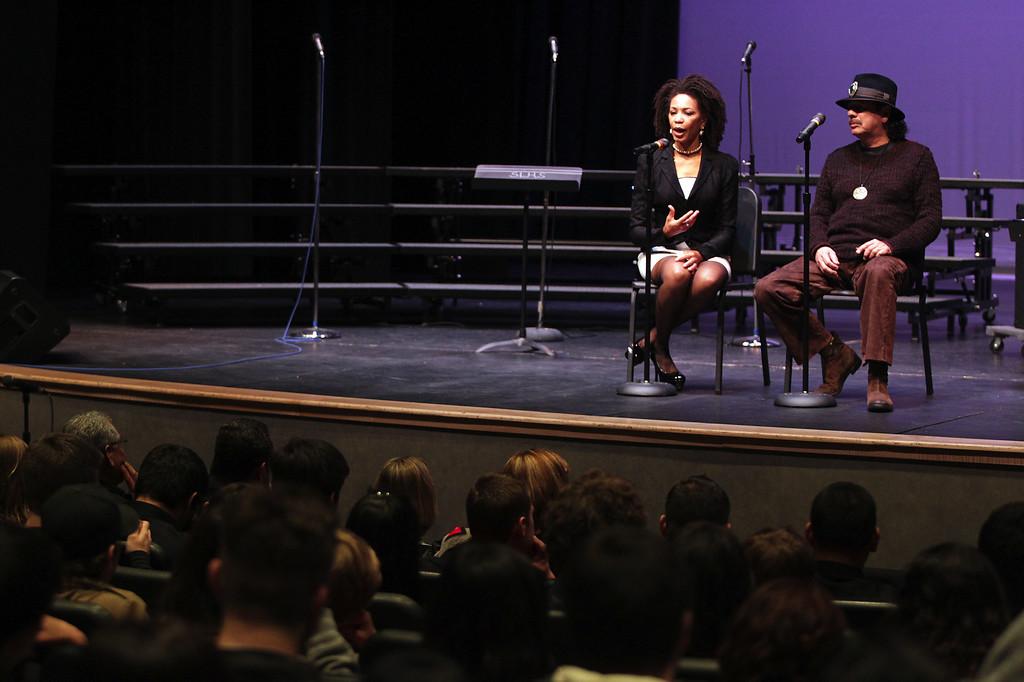 . Cindy Blackman Santana and husband Carlos Santana, from left, speak to music students at San Leandro High School in San Leandro, Calif., on Wednesday, Jan. 9, 2013. (Anda Chu/Staff)