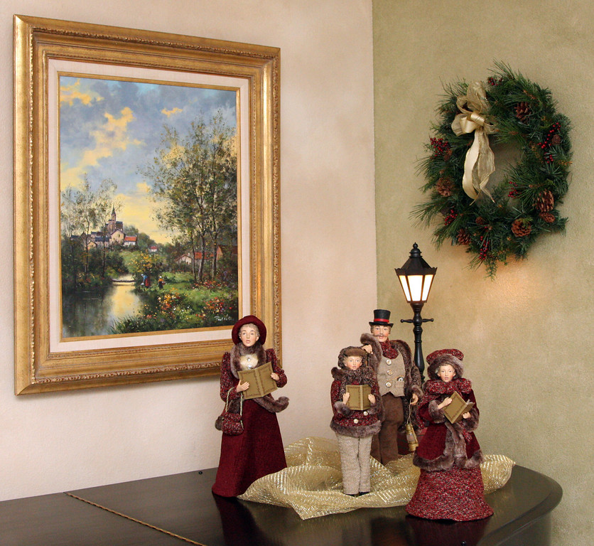 . A set of Victorian themed carolers are displayed on top of a grand piano in the living room on Gladys Young\'s Danville, Calif., home on Wednesday, Nov. 28, 2012. She decorates many of the rooms with a variety of themes. (Jim Stevens/Staff)
