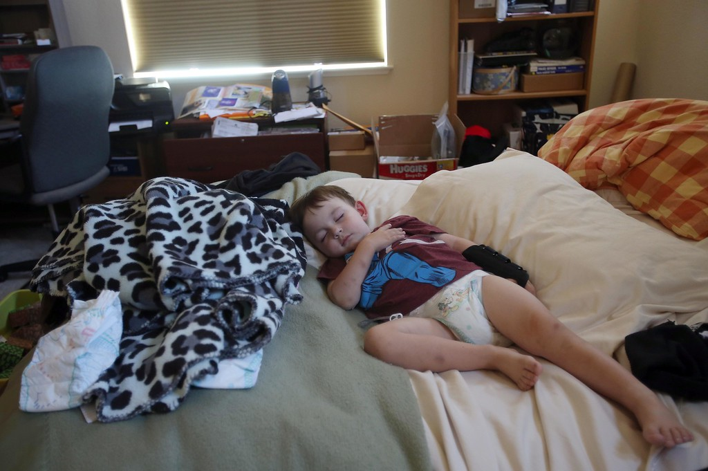 . Matthew Ouimet, 3, takes a nap on his parent\'s bed at their home in Antioch, Calif., on Thursday, May 22, 2014. (Jane Tyska/Bay Area News Group)