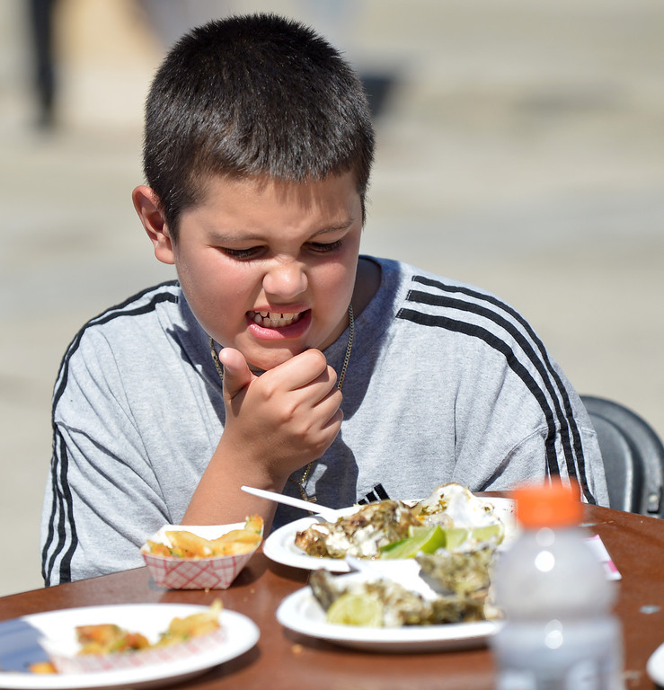 . Santino Melhado, 10, of Antioch, ponders the barbecue oysters on his plate at the 29th annual Pittsburg Seafood and Music Festival in the city\'s historic Old Town in Pittsburg, Calif., on Saturday, Sept. 7, 2013. (Dan Rosenstrauch/Bay Area News Group)