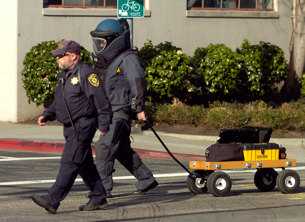 . A bomb technician walks toward a building at 5885 Hollis St. that received a bomb threat in Emeryville, Calif. on Wednesday, Feb. 6, 2013. Two floors of the  building house facilities for Lawrence Berkeley National Laboratory. (Kristopher Skinner/Staff)