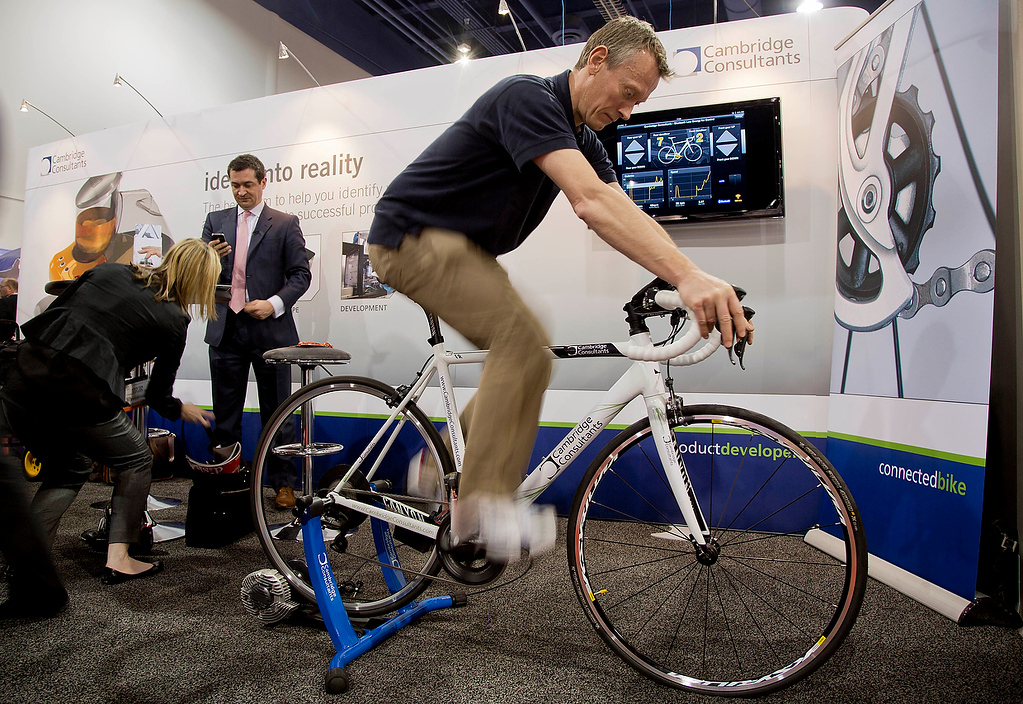 . A wireless bike is demonstrated at the at the Cambridge Consultants booth at the Consumer Electronics Show, Wednesday, Jan. 9, 2013, in Las Vegas. The bike\'s gears can be changed with a mobile device either by the rider or by the device which monitors the rider\'s cadence. (AP Photo/Julie Jacobson)