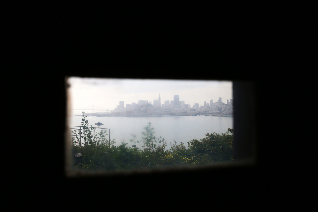 . The skyline of San Francisco is photographed through a window in the main cellhouse of Alcatraz Island on Monday, March 18, 2013 in San Francisco, Calif. The federal prison on the island closed 50 years ago and is now a tourist destination.  (Aric Crabb/Staff)