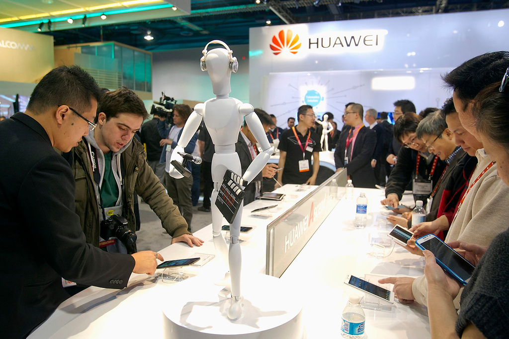 . Show attendees look over the Ascend Mate smart phone with a 6.1-inch screen, at the Huawei booth during the first day of the Consumer Electronics Show (CES) in Las Vegas January 8, 2013. (REUTERS/Steve Marcus)