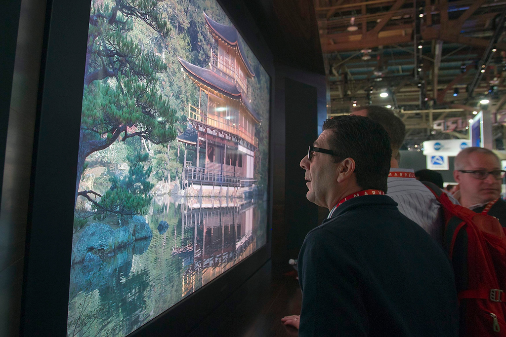 . William Minna gets a close look at an Sharp 85-inch 8K prototype television during the first day of the Consumer Electronics Show (CES) in Las Vegas January 8, 2013. The television has 16 times the resolution of 1080p.(REUTERS/Steve Marcus)
