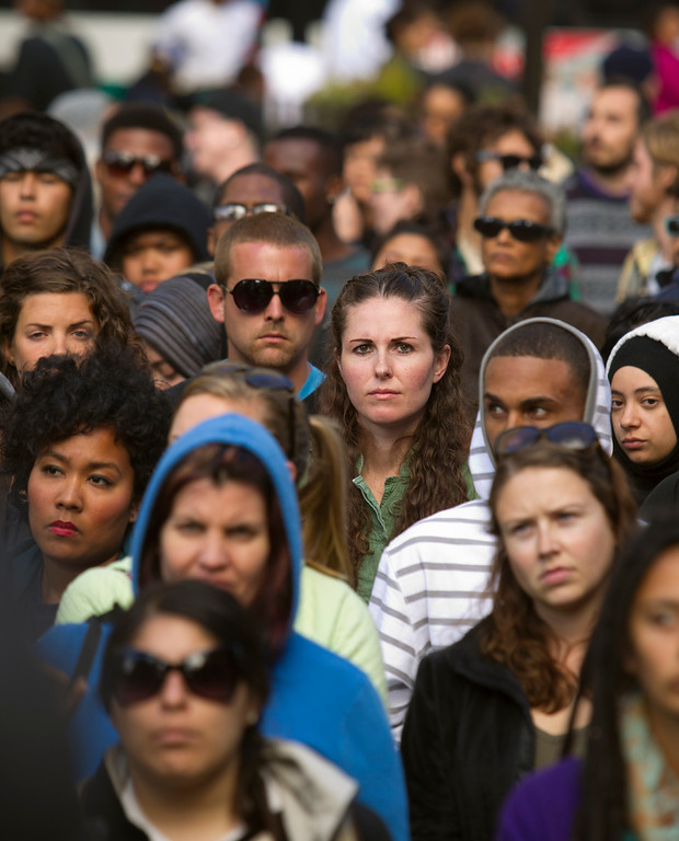 . Demonstrators listen to calls for action during a protest at Frank H. Ogawa Plaza of the verdict in the Trayvon Martin murder trial last Saturday in Sanford, Fla., Monday, July 15, 2013 in Oakland, Calif. (D. Ross Cameron/Bay Area News Group)