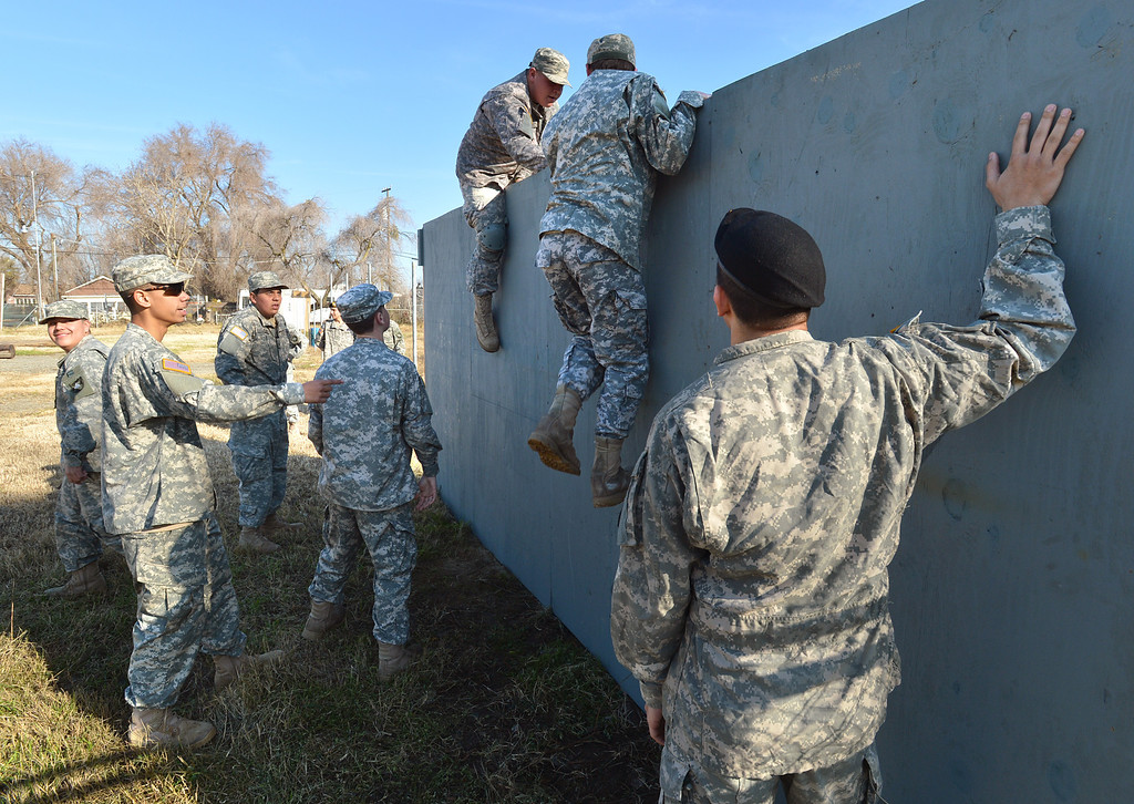 . A group of Boy Scouts try to climb over a wall during an exercise at their battalion headquarters in Bethel Island, Calif., on Saturday Jan. 19, 2013. A group of eighteen boys are in a branch of the Boy Scouts know as Venturing. The East County club, the only Army-oriented one in northern California , not only gives kids a taste of military life but teaches them respect for authority, courtesy and self-confidence. (Dan Rosenstrauch/Staff)