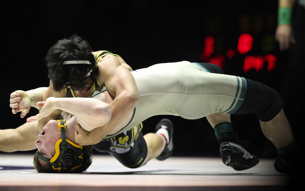 . Paradise\'s Wyatt Wyckoff, bottom, wrestles against San Fernando\'s Johnny Parada in the 126-pound championship match during the California Interscholastic Federation wrestling championships in Bakersfield, Calif., on Saturday, March 2, 2013. Parada would go onto win the match 13-6. (Anda Chu/Staff)