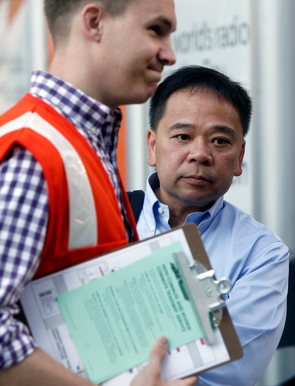 . Gary Luk of Pleasanton is stuck waiting at the AC Transit terminal in downtown San Francisco wondering how he will get back to Pleasanton for an emergency on Monday morning, July 1, 2013, the first day of the BART strike. Luk had just arrived after a two hour commute aboard a special BART charter bus when he received an emergency call to return home for a sick child. The BART charter bus return ticket would not be good until the afternoon commute and he was forced to find yet another alternate route across the bay. (Karl Mondon/Bay Area News Group)