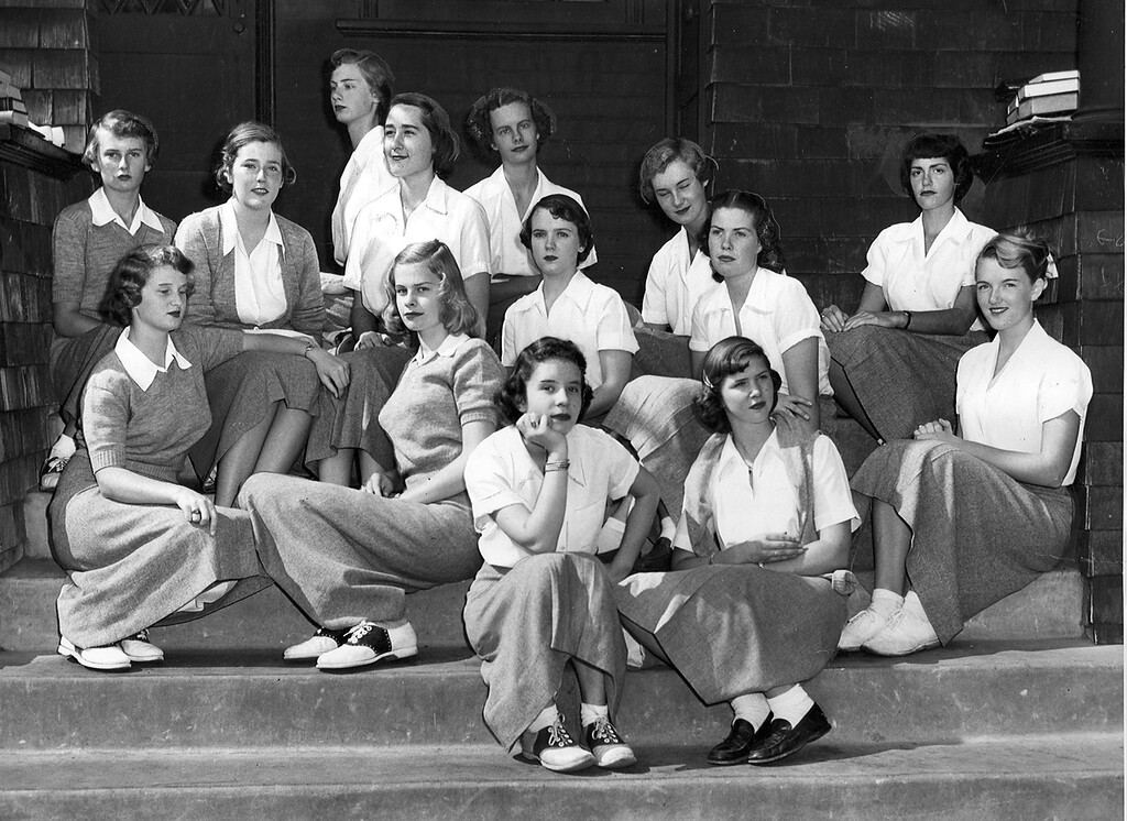 . Anna Head School students, l-r front, Joan Fox, Wesley Riersel, Carolyn Henderson, Lois Ann Blemer, and Gerry Wise, l-r back row, Nancy Budlong, Barbara Clark, Eva Mendel, Peggy Carmack, Persis Gearing, Barbara Moyle, Mancee Ewer, Marilyn Hanna and Marlene Marks   duplicate a pose of their predecessors from a 1894 photo on the steps of Anna Head School in 1950. (Oakland Tribune Archives)