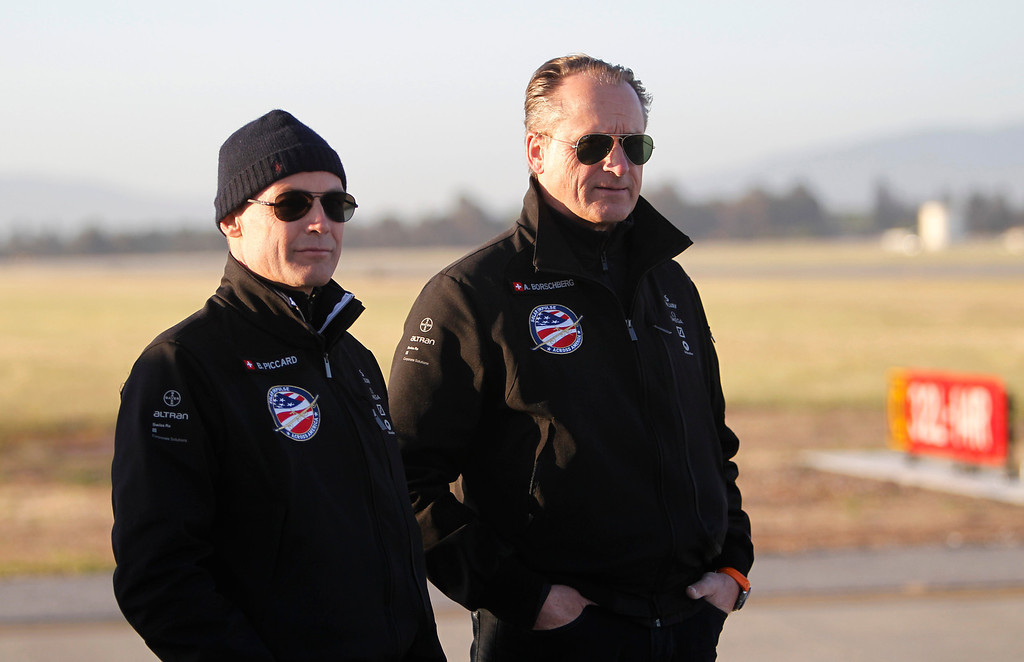 . Bertrand Piccard, left, and fellow pilot Andre Borschberg wait for the Solar Impulse, the experimental airplane, to land after a test flight at Moffett Airfield in Mountain View, Calif. Friday morning April 19, 2013.  (Patrick Tehan/Staff)
