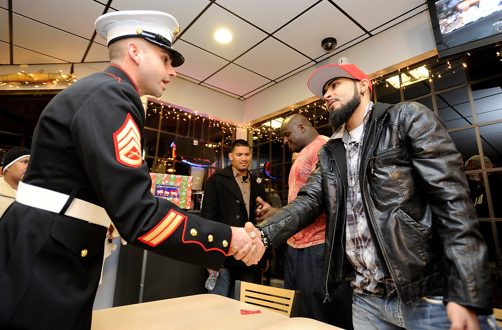 . Marine Corps Reserve Staff Sgt. Erick Bannar shakes hands with Giants reliever Sergio Romo at a Toys For Tots event held at Kinder\'s Meats and Deli on Wednesday, Dec. 12,  2012, in Pleasant Hill, Calif. Bannar said 2,745 toys were collected at the event where fans received an autograph after donating a toy. (Susan Tripp Pollard/Staff)