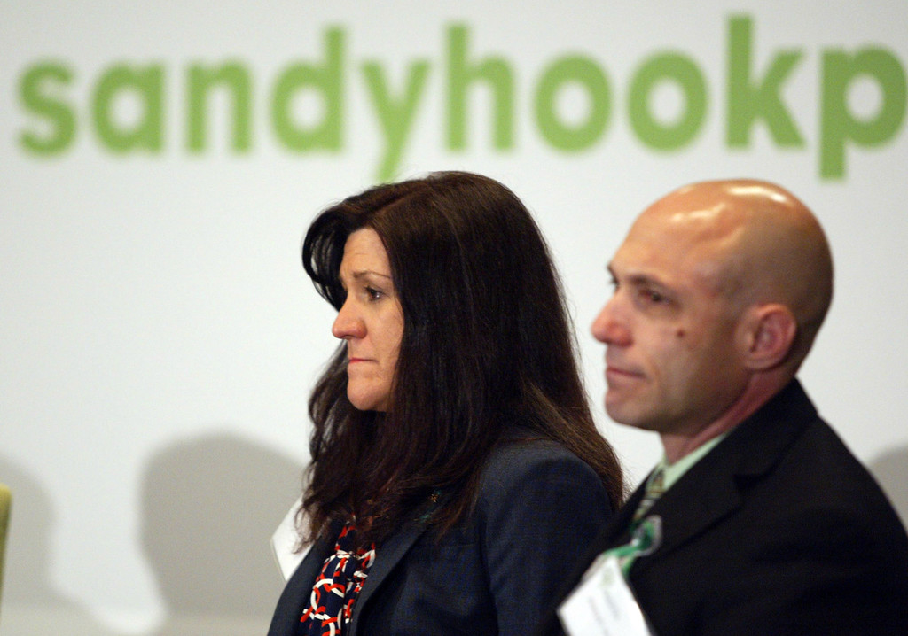 . Parents of Avielle Richman, 6, one of the victims in the Sandy Hook school shooting, Jennifer Hensel and Jeremy Richman attend a town-hall-style forum during the launch event for the Sandy Hook Promise Innovation Initiative held in honor of the three month anniversary of the tragic shooting at Sandy Hook Elementary School at the Bill Graham Civic Auditorium in San Francisco, Calif., on Thursday, March 14, 2013. (Anda Chu/Staff)