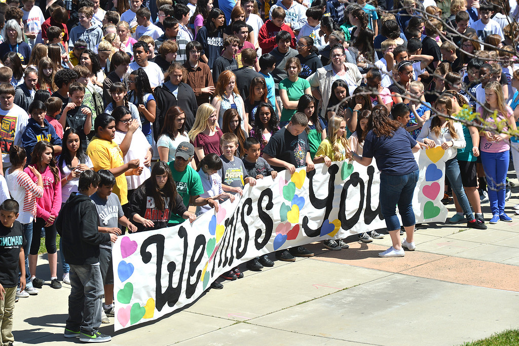 """. Martinez Junior High School students unroll a banner with \""""We Miss You\""""\"""" which was to be used while shooting a video to send well wishes to fellow student Aaron Hern in Martinez, Calif., on Friday, April 19, 2013. Hern is recovering in Boston at Children\'s Hospital after being severely injured at the Boston Marathon explosion last Monday. (Dan Rosenstrauch/Bay Area News Group)"""