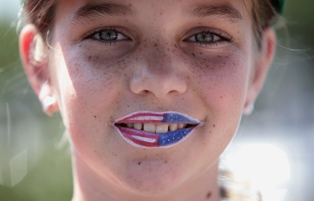 . Fiona Simpson, 13, showed her colors during the annual Fourth of July parade in Redwood City, Calif. on Thursday, July 4, 2013. Considered the largest Independence Day parade in Northern California, it is celebrating its 75th year. (Gary Reyes/Bay Area News Group)