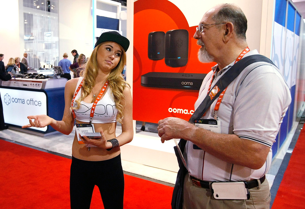 . Sherra Rustad working for Polk Audio tells a showgoer about Boom speakers on the second day of the Consumer Electronics Show (CES) in Las Vegas January 9, 2013. (REUTERS/Rick Wilking)