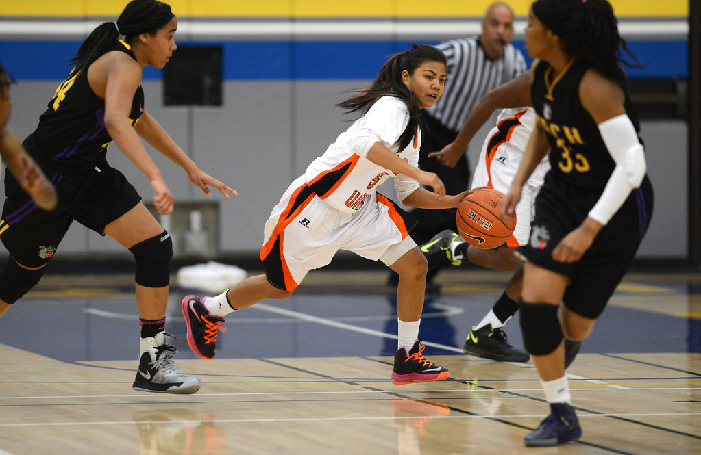 . McClymonds High\'s Romanalyn Inocencio (5) on the move against Oakland Tech High in their Oakland Section high school girls basketball championship game played at Merritt College in Oakland, Calif. on Thursday, Feb. 28, 2013. (Dan Honda/Staff)