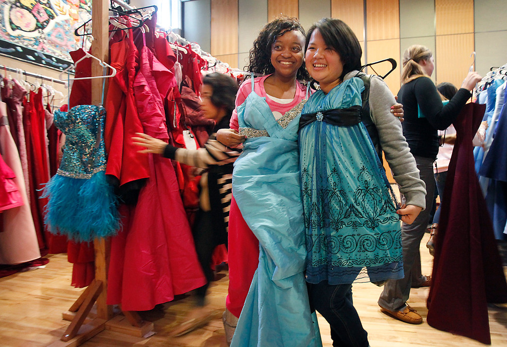 . Kanyetta Dorsey and Michelle Lee, both 18-year-olds from Piedmont High, make their selections at Operation Prom Dress which held its fifth annual giveaway Sunday, March 10, 2013 at Seven Trees Community Center in San Jose, Calif. 800 girls were given the opportunity to pick a prom dress without any worry about the expense.  Since 2009, the office of Vice Mayor Madison Nguyen has given out more than 3000 dresses. (Karl Mondon/Staff)