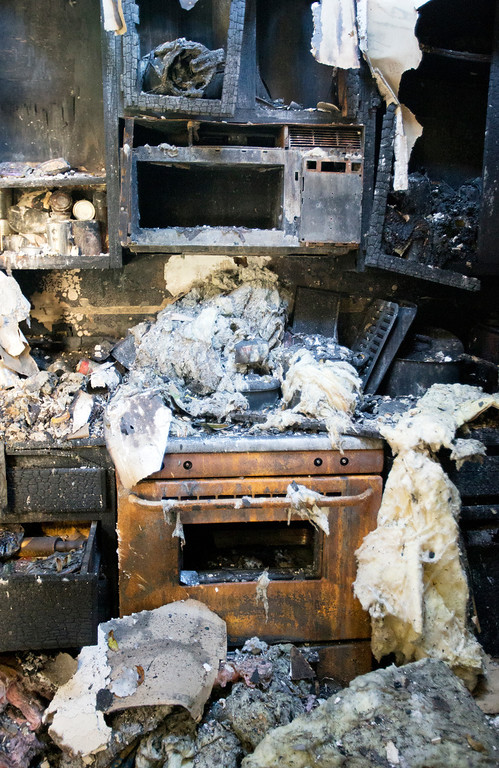 . The stove and microwave, which were bought in November on Black Friday were destroyed in the December fire that  blazed through Anna Paasi and Uatesoni Paasi\'s house, in San Mateo, Calif. on Thursday, Jan. 2, 2014.  (LiPo Ching/Bay Area News Group)